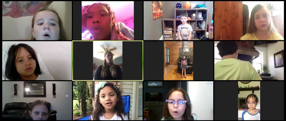 Kids in Metairie singing online during Voice class!